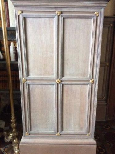 Oak panelling  with a chalky wash and gilded corners